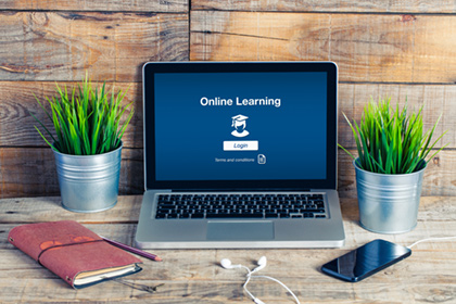 Online learning login screen on a laptop.